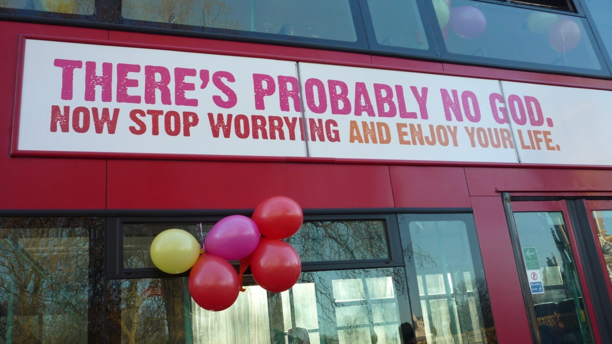 """There's probably no God. Now stop worrying and enjoy your life."" printed on the side of a bus"